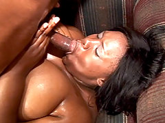 Huge black babe Tina Taboo gags on a plump cock and receives and hard pounding in her wet pussy